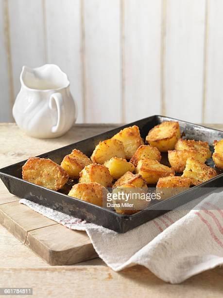 Roast potatoes with crispy seasoning in tray