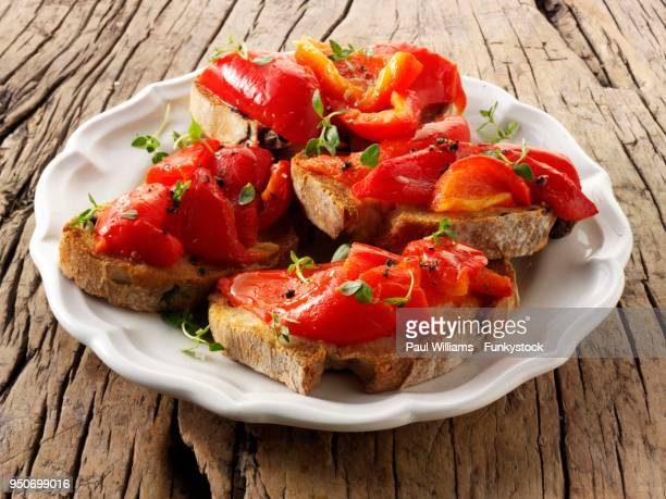 roast red peppers on toasted rye bread sandwiches, bruschettas - roasted pepper stock photos and pictures