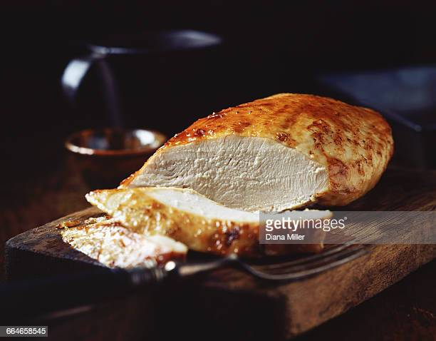 Roast turkey breast on rustic wooden chopping board