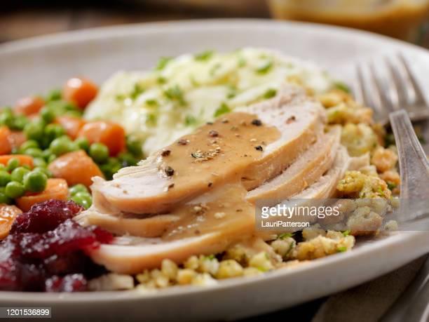 roast turkey dinner - roast turkey stock pictures, royalty-free photos & images
