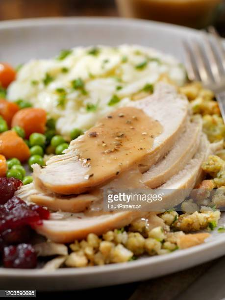 roast turkey dinner with stuffing,mashed potatoes, cranberry sauce, peas, carrots and gravy - canadian thanksgiving stock pictures, royalty-free photos & images