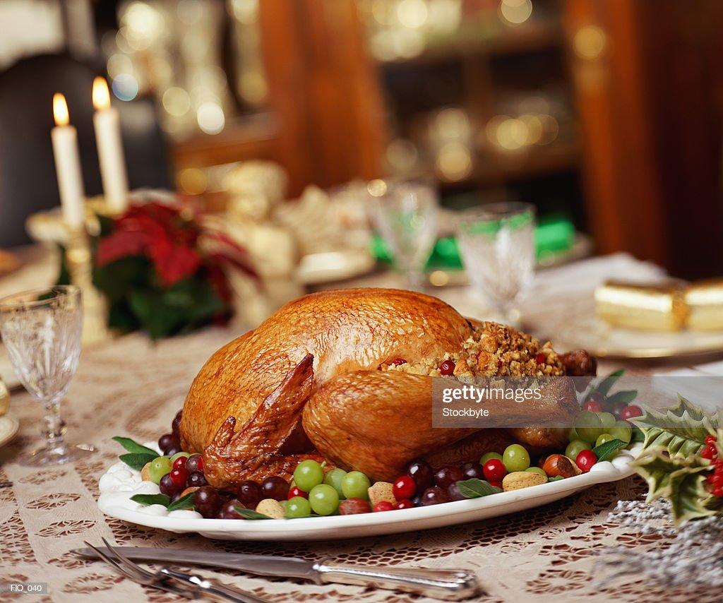 Roast turkey on dinner table : Bildbanksbilder