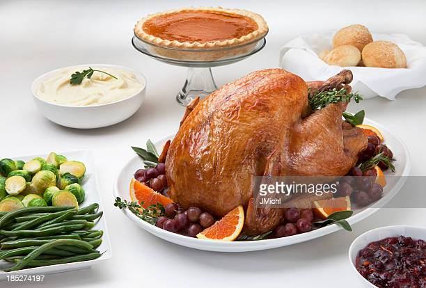 Roast turkey served with trimmings on a white table