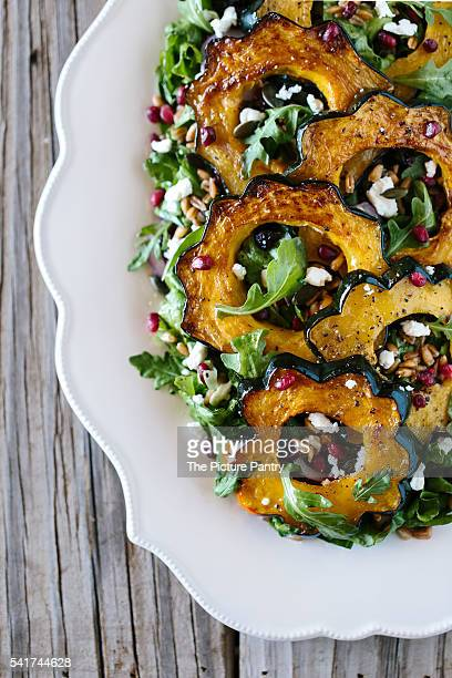Roasted Acorn Squash Salad with Spicy Pepitas and Cranberries