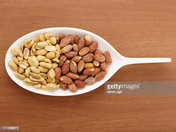 Roasted And Salted Peanuts In A White Plate