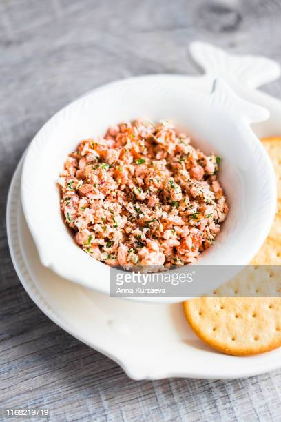 roasted and smoked salmon fish, soft cheese and egg pate or rillette in a bowl served with crackers, selective focus - anna planken stock-fotos und bilder