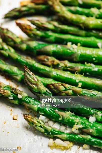 roasted asparagus with lemon zest and garlic - asparagus stock pictures, royalty-free photos & images