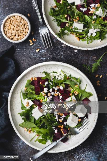 roasted beet and feta salad with arugula - nut food stock photos and pictures