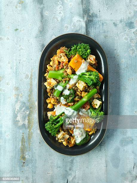 Roasted butternut squash and tender stem broccoli, tofu, lentils, chick peas, pine nuts
