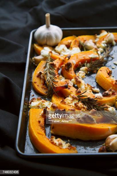 Roasted butternut squash wedges with feta, rosemary and harissa
