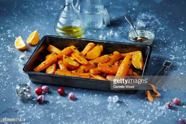 roasted carrots in roasting tin, seasonal christmas food - roasted stock pictures, royalty-free photos & images