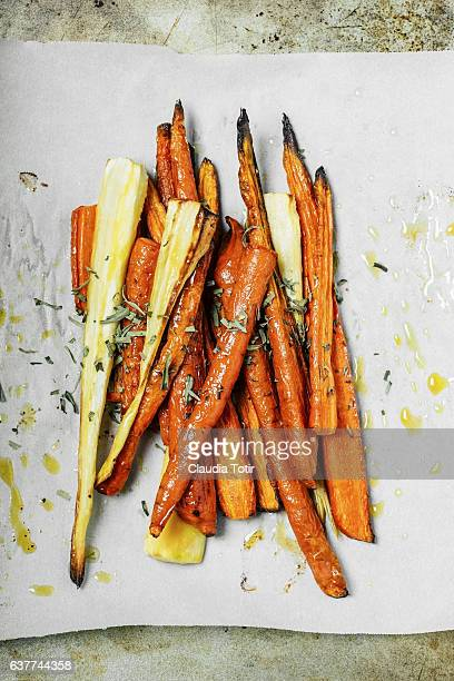 roasted carrots - root vegetable stock pictures, royalty-free photos & images