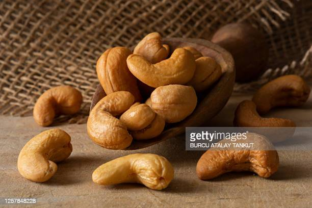 roasted cashews - cashew stock pictures, royalty-free photos & images