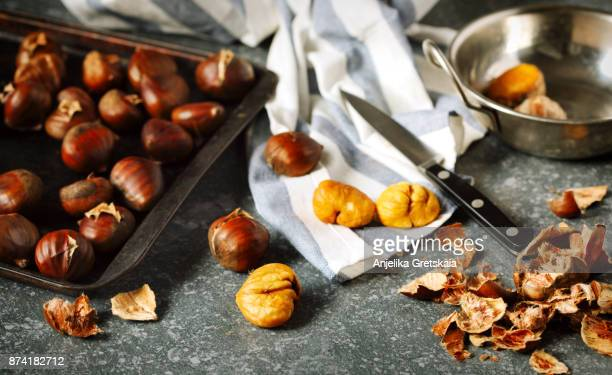 roasted chestnuts. - marrone foto e immagini stock