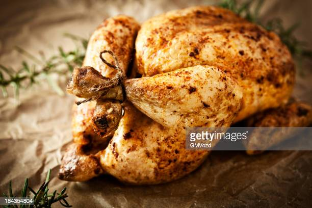 Roasted chicken on brown wrapping paper