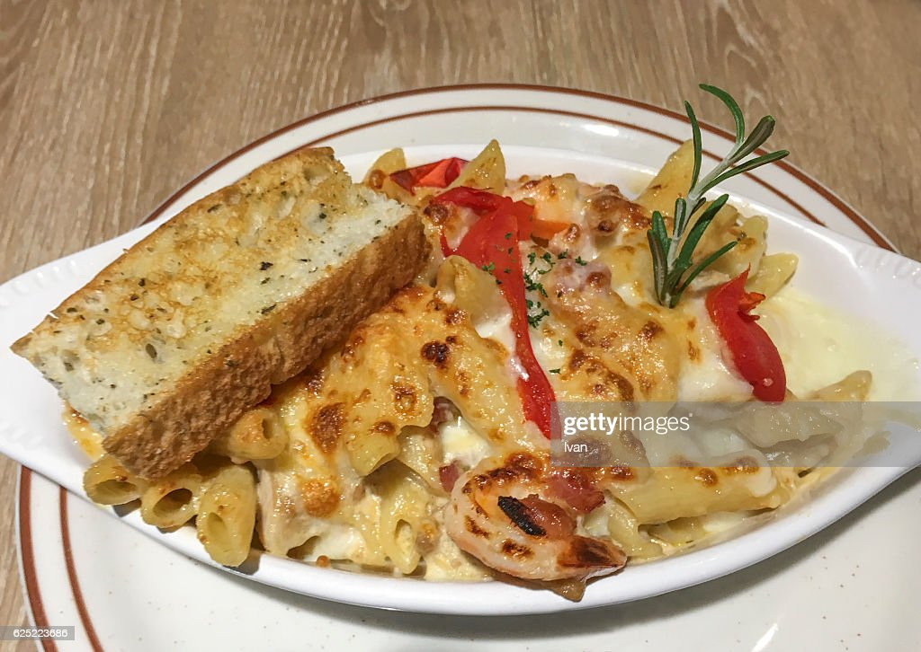 Roasted Chicken White Cream Cheess Sauce And Penne Pasta With Cheese Topping Focaccia Bread