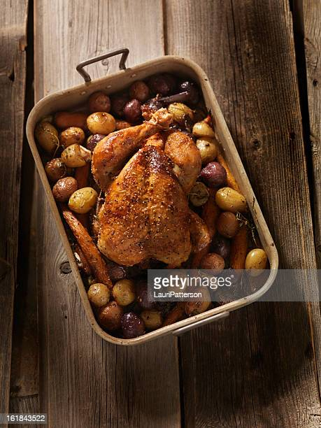 roasted chicken with carrots and potatoes - roast chicken stock pictures, royalty-free photos & images