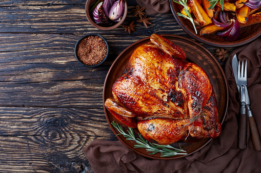 roasted chicken with grilled pumpkin slices 1061638926