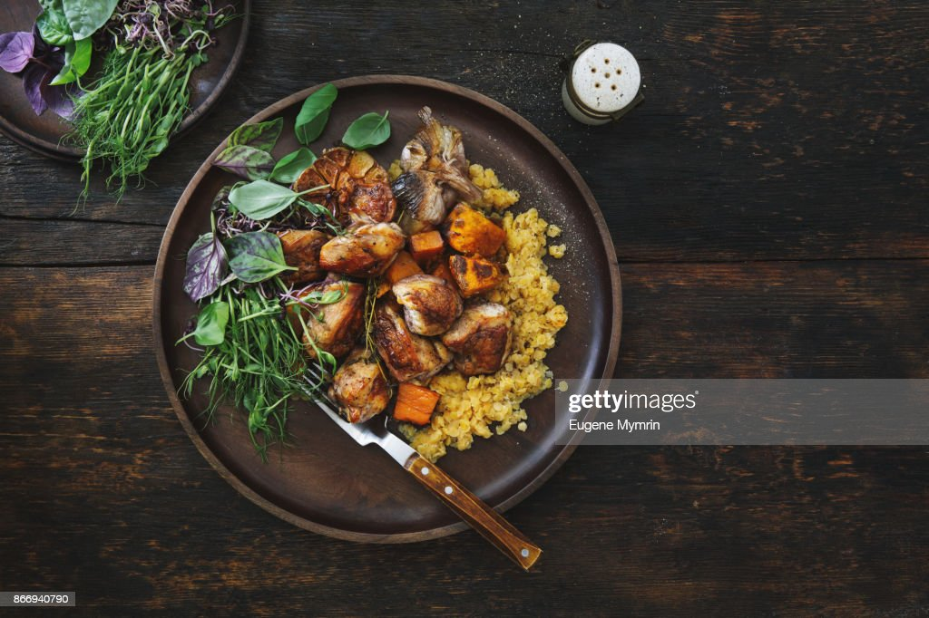 Roasted chicken with pumpkin and lentils : Stock Photo