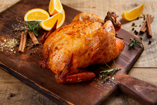 Roasted chicken with spices 841452394