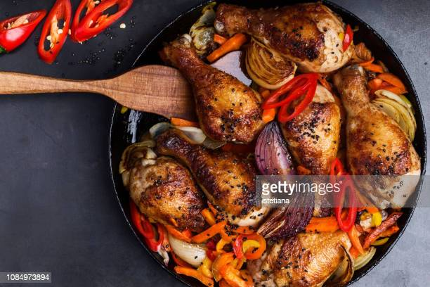 roasted chile miso  chicken drumsticks  with bell pepper - chicken meat stock pictures, royalty-free photos & images