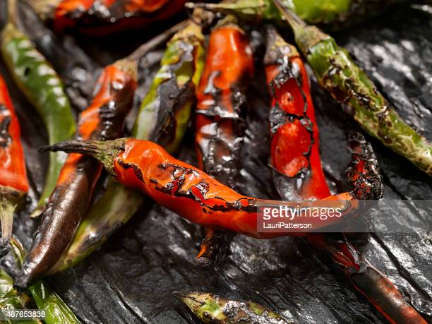 roasted chili peppers - roasted pepper stock photos and pictures