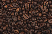 Roasted coffee beans. Background, close-up top view. Healthy breakfast.
