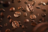 Roasted coffee beans falling down