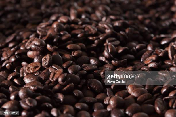 roasted coffee beans filling the frame - caffeine stock pictures, royalty-free photos & images