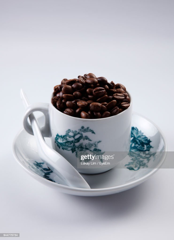 Roasted Coffee Beans In Cup On White Background : Stock Photo