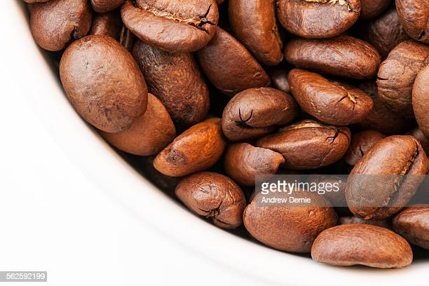 roasted coffee beans - andrew dernie stock pictures, royalty-free photos & images