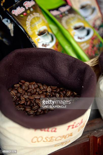 Roasted coffee grains from the central mountains of Peru are exhibited at a street fair in Lima on August 27 2015 Producers attempt to recover the...