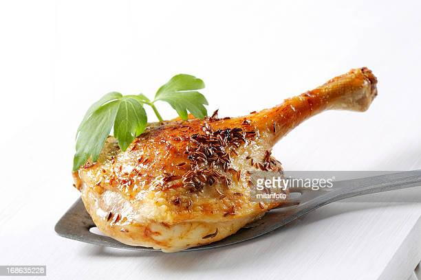 Roasted duck leg on a spatula