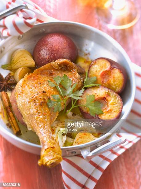 roasted ducks leg with plums and spicies - canard photos et images de collection