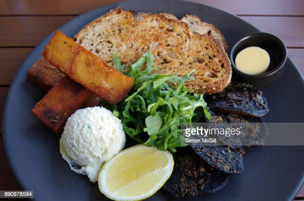 Roasted field mushrooms with basil pesto, hash browns, herb ricotta, arugula, seeded rye bread, fresh lemon and butter