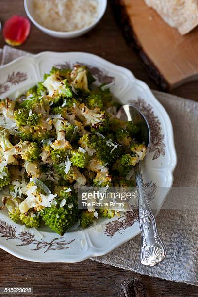 Roasted florets of Romanesco broccoli with Parmesan cheese on a plate