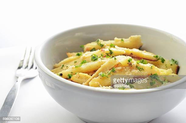 Roasted Garlic and Horseradish Parsnips with Parsley in a Bowl