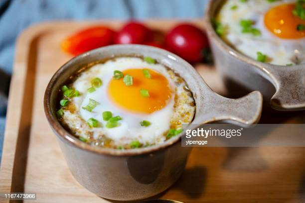 roasted gravy rice with egg - baked stock pictures, royalty-free photos & images
