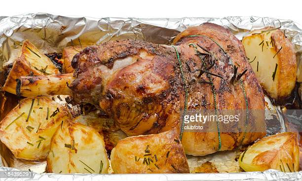 roasted leg of lamb and roast potatoes - leg of lamb stock pictures, royalty-free photos & images