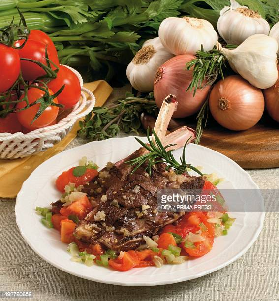 Roasted mutton cutlets on a bed of stewed tomatoes and celery