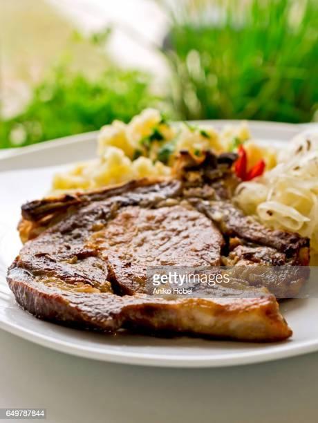 Roasted pork chop with garnish