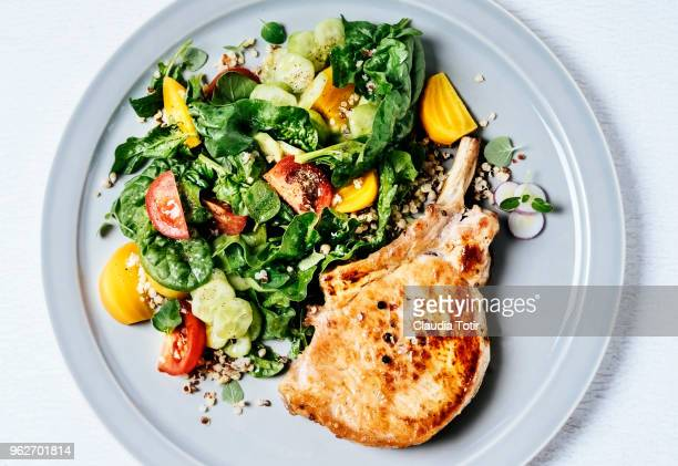 Roasted pork chop with salad