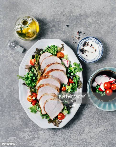 roasted pork with fresh salad - pork stock pictures, royalty-free photos & images