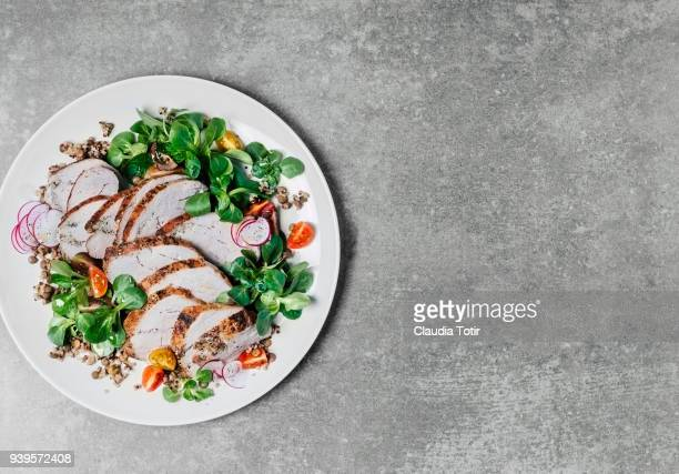 roasted pork with lentils and fresh salad - pork stock pictures, royalty-free photos & images