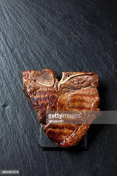 Roasted porterhouse steak on black