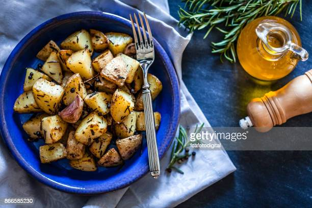 Roasted potatoes in a blue plate