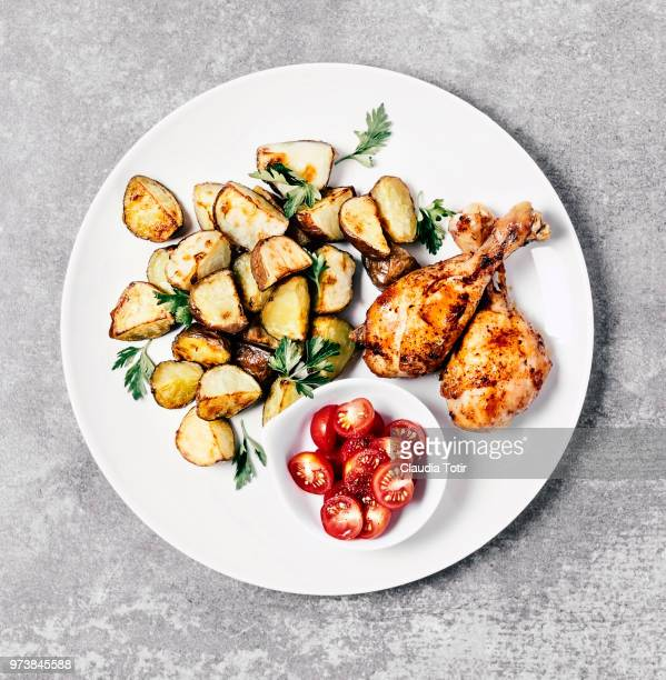 Roasted potatoes with chicken and tomato salad