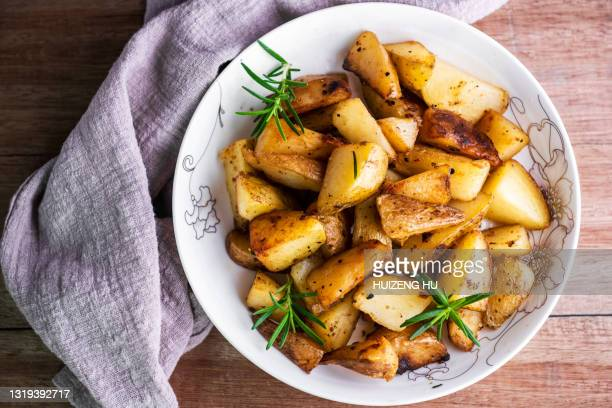 roasted potatoes with rosemary top view - ローストポテト ストックフォトと画像