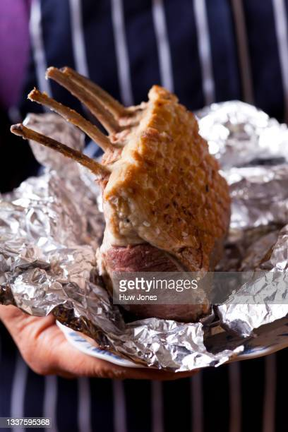 roasted rack of lamb on a vintage blue and white plate - animal body part stock pictures, royalty-free photos & images