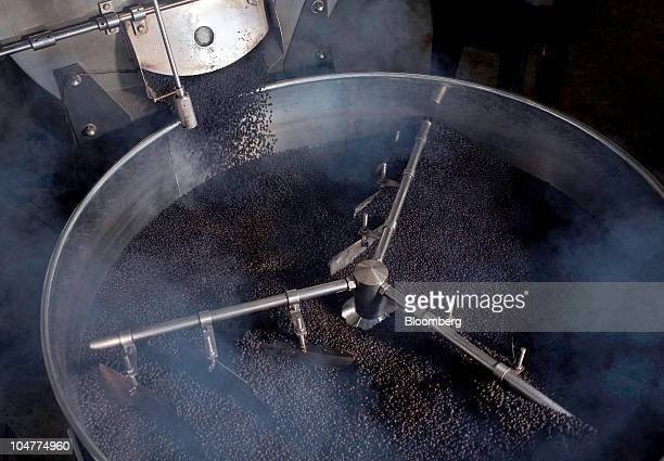 Roasted robusta coffee beans are turned in the cooling tray of a 100kilogram batch roaster at the Highlands Coffee processing plant in Ho Chi Minh...